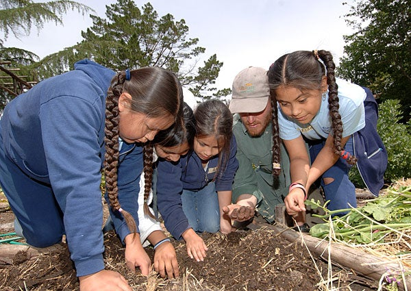 Yamilet Paredes, Erika Gonzalez, Adriana Villanueva, Drew Harwell and Elizet Cruz-Bravo check out the compost heap in Jesse Cool's garden