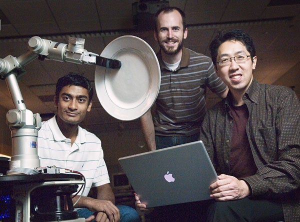 Graduate students Ashutosh Saxena and Morgan Quigley and Assistant Professor Andrew Ng