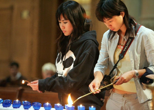 Students lighting candles