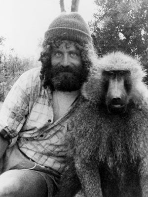 Robert Sapolsky with Rock, one of many wild baboons that he has studied in Kenya's Serengeti