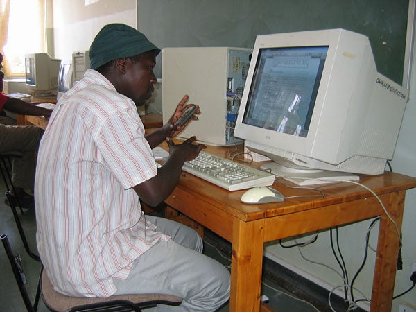 A student works at a computer at Mweka College