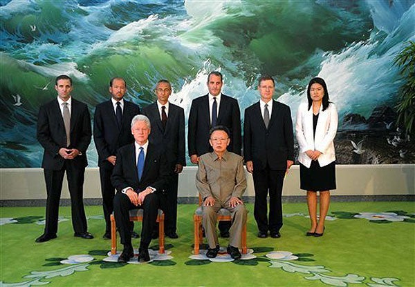 Former President Bill Clinton, North Korean leader Kim Jong Il seated. Standing behind, second from the right is David Straub, associate director of the Korean Studies Program in the Walter H. Shorenstein Asia Pacific Research Center.