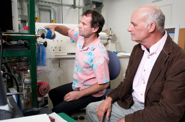 Professor Page Chamberlain observes Peter Blisniuk, Stable Isotope Lab manager, as he performs an isotope analysis of a rock sample.