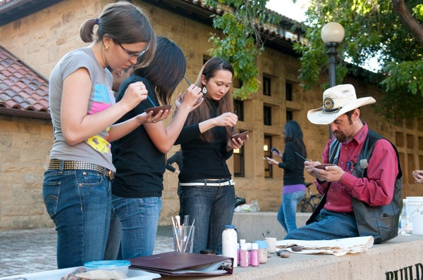 Stanford students and members of the community worked together on the Inca pottery in the open air behind Building 500.