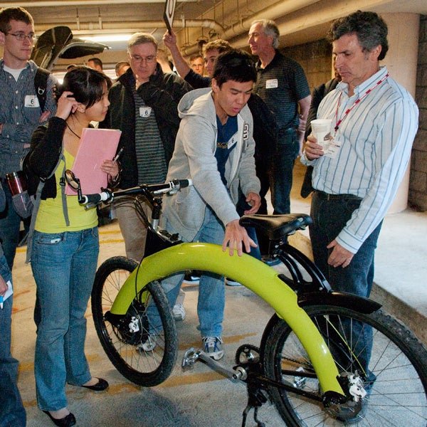 At the show, students inspected vehicles from Pi Mobility. Founder and CEO Marcus Hays, right, was on hand to answer questions about the electic motor bikes he builds in Sausalito, CA.