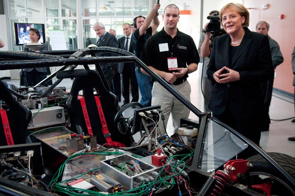 Students, faculty and Volkswagen officlals walked Chancellor  Merkel through Stanford's Volkswagen Automotive Innovation Lab.