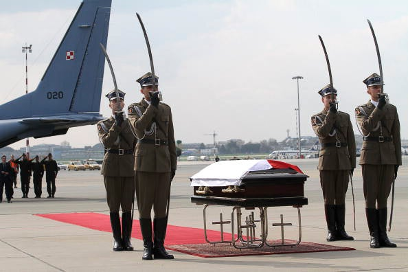 Soldiers salute next to the coffin of Polish President Lech Kaczynski