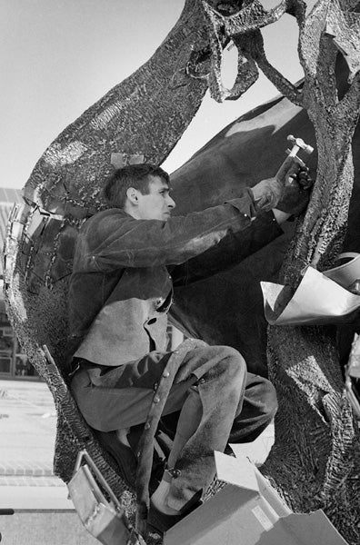 Aris Demetrios works on the installation of his first commission, White Memorial Fountain in 1964.