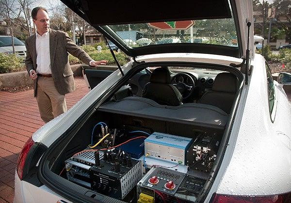 Graduate research team leader Chris Gerdes, shows off the systems carried onboard the autonomous car, a modified Audi TTS.