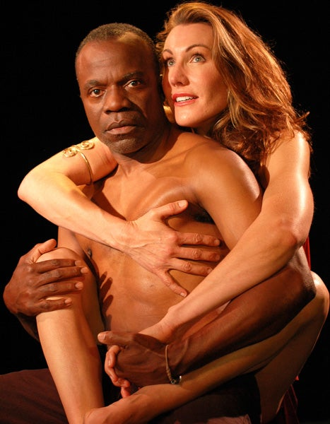 Calypso (Courtney Walsh) clings to Odysseus (L. Peter Callender).