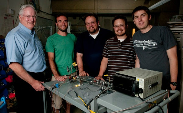 Professor Brian Cantwell, graduate student Yaniv Scherson, Professor Craig Criddle, and graduate students George Wells and Koshlan Mayer-Blackwell in the Cantwell lab with the nitrous oxide decomposition cell.