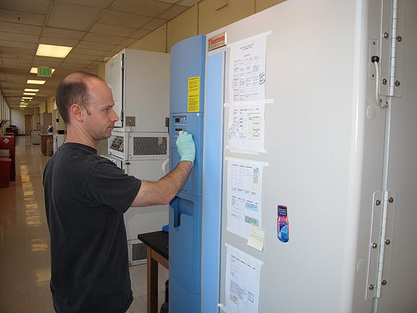 Darren Morrow checks the temperatures on a new high-efficiency freezer