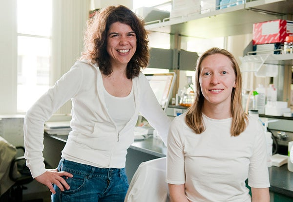 Postdoctoral student Ashley Webb, right, was one of the students who nominated Assistant Professor Anne Brunet for the mentoring award.