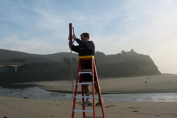 Nick de Sieyes installing a water monitoring instrument at Stinson Beach.