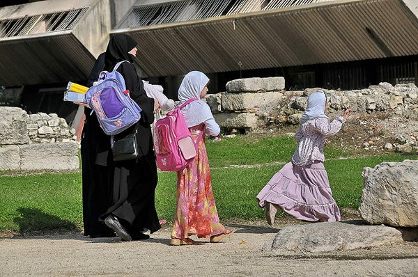 Muslim women and girls at Le Jardin des Vestiges Park in Marseille.