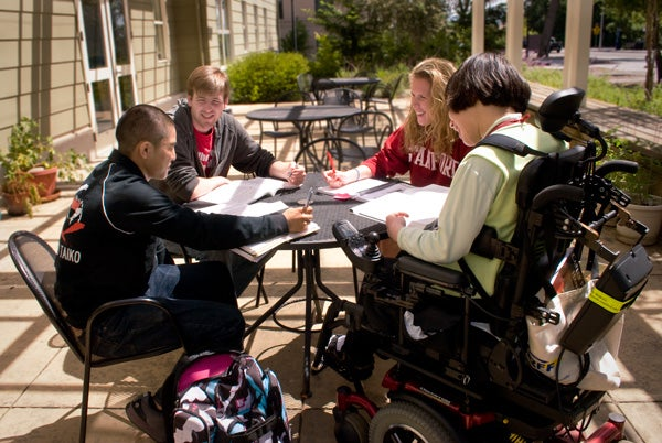 Students, including one using a wheelchair