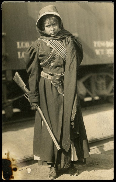 Postcard of Mexican girl with gun