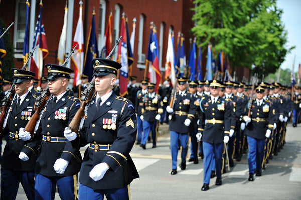 Soldiers in dress uniforms marching