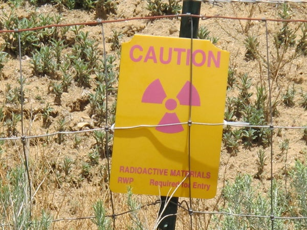 Sign reading 'Caution radioactive material'