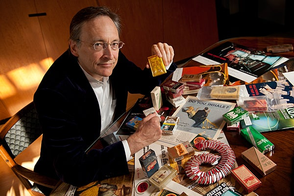 Robert Proctor with collection of cigarette ads and packages