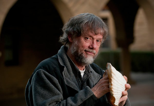 Professor John Rick holds a conch shell similar to the ones discovered at the Chavin site.