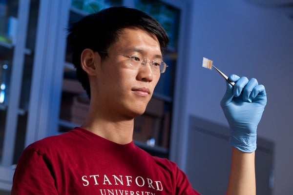 Graduate student Yuan Yang with transparent battery