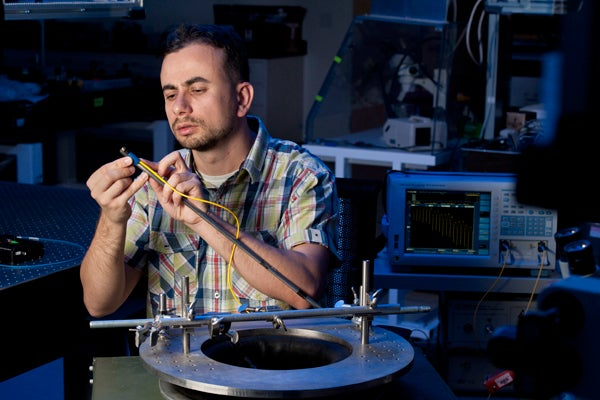 Onur Kilic, postdoctoral fellow at the Center for Nanotechnology, prepares to test a microphone.