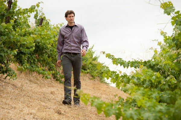 Noah Diffenbaugh walking in a vineyard