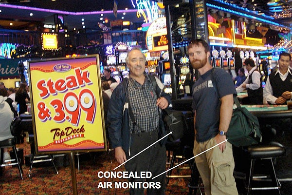 Two men with backpacks concealing air monitors outside casinos.