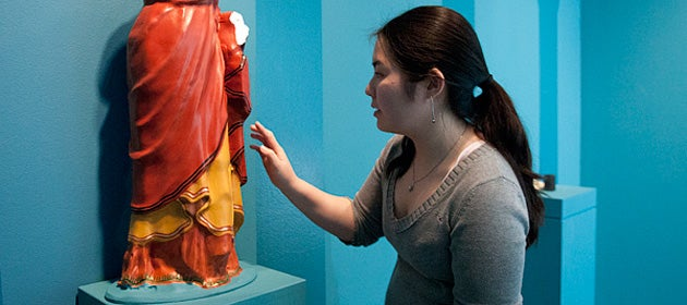 Student Ivy Nguyen with a replica of how ancient statue may have originally looked