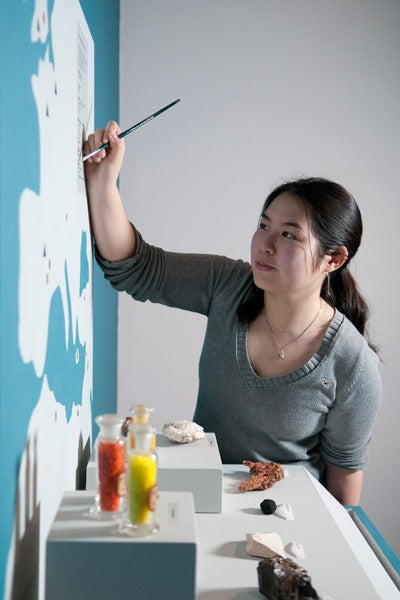 Ivy Nguyen works on display
