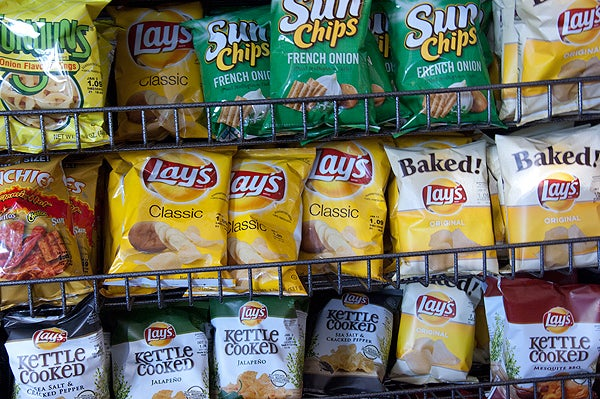 Shelf of various bands of potato chips