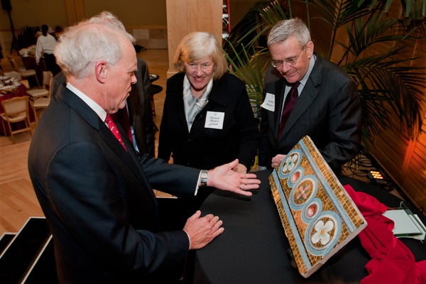 John Hennessy left, Eleanor Hewlett Gimon and Walter Hewlett with a portion of mosaic of the original Memorial Church