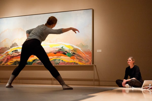 Dancer practicing in front of a painting