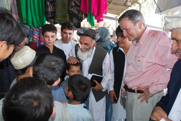 Then-Ambassador Karl Eikenberry, right, visits the Lashkar Gah bazaar