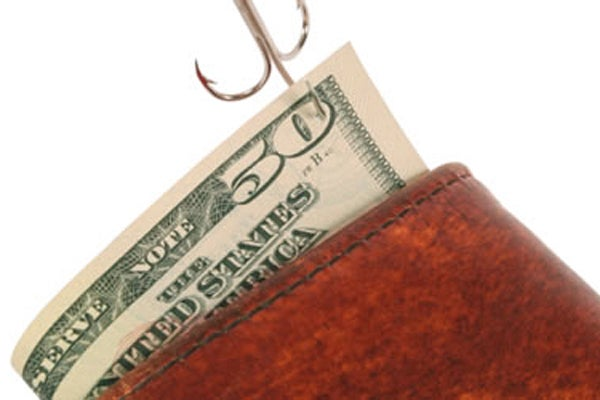 Money being pulled from a wallet by a hook