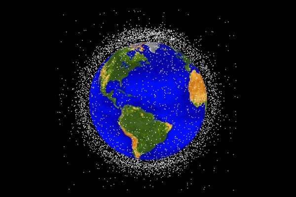 Image of the Earth with white dots signifying junk all around it