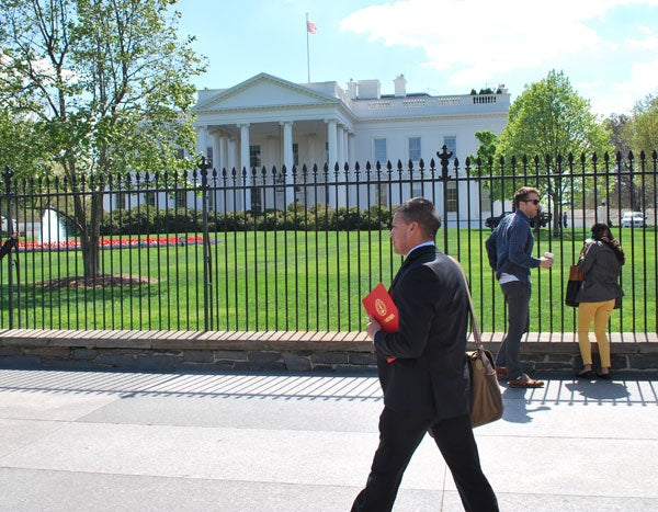 Graduate student Diego Román walks past the White House during Stanford's DC Boot Camp.