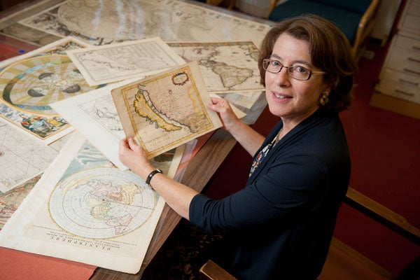 Julie Sweetkind-Singer, head librarian, Branner Earth Sciences Library & Map Collections, with some of the maps depicting California as an island.