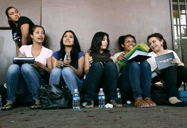Students wait in line for assistance with paperwork for the Deferred Action for Childhood Arrivals program in Los Angeles on Aug. 15, 2012.