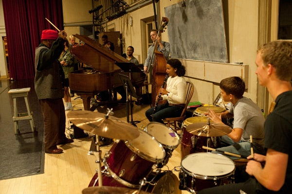 William Parker directing musicians in the Chocolate Heads movement band as they rehearse for their spring performance in the Bing Concert Hall