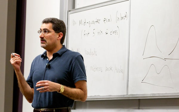 Professor Mehran Sahami teaches a class in the NVIDIA Auditorium