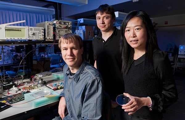 Professor Ada Poon, right, with graduate students Daniel Pivonka, left, and Anatoly Yakovlev, center.