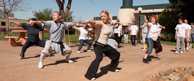 Lisa Becker, a biology research assistant, learns Shaolin Kung Fu from the masters in the class at Stanford.