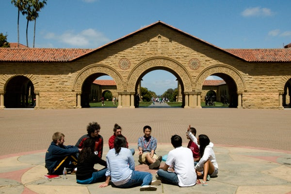 Students sitting in the main Stanford quadrangle
