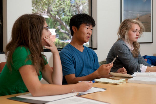 Rachel Baron, Ryan Lee and Abby Coleman participate in a small group discussion activity in the Summer Humanities Institute.