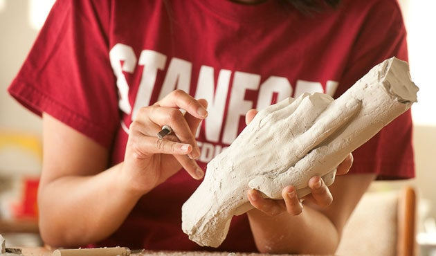 Medical student Lori Lee works on a second casting of a piece featured in an exhibit at  Medicine and the Muse.