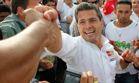 Enrique Pena Nieto greets supporters during a campaign rally days before the July 1 election.
