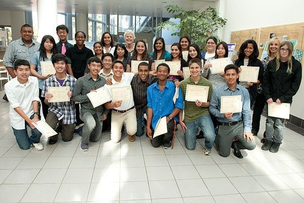 Graduates of the RISE program gathered for a picture after their poster event and celebration.