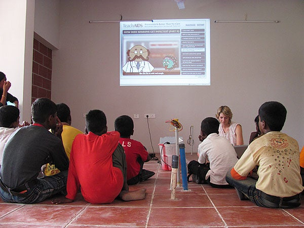 Youth watch TeachAIDS animations at a Rising Star Outreach health seminar in a leprosy colony in Tamil Nadu, India.